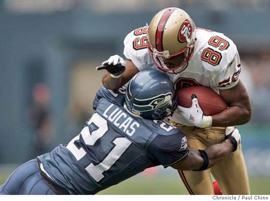 49ers27_110_pc.jpg Curtis Conway is stopped by Seattle's Ken Lucas in the second quarter. San Francisco 49ers vs. Seattle Seahawks at Qwest Field on 9/26/04 in Seattle, WA. PAUL CHINN/The Chronicle MANDATORY CREDIT FOR PHOTOG AND S.F. CHRONICLE/ - MAGS OUT Sports#Sports#Chronicle#10/16/2004#ALL#5star##0422375711 Photo: PAUL CHINN