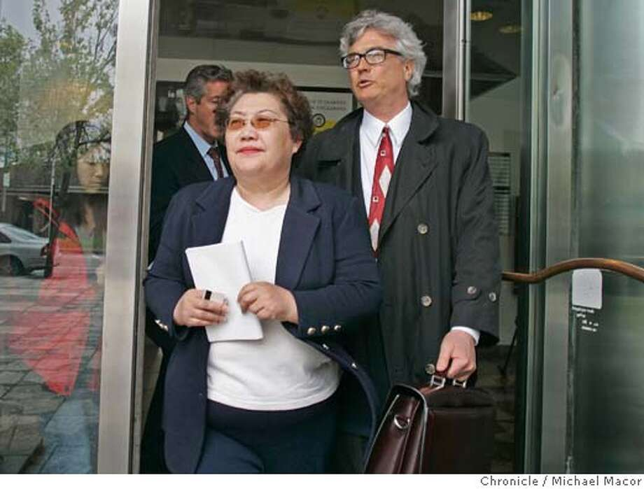 Julie Lee leaves the San Francisco County Jail Building, after turning herself in and than posting bail. Joined by her attorney Steve Gruehl. Julie Lee State, top volunteer fund-raiser for former Secretary of State Kevin Shelley, was charged by state prosecutors with grand theft and other felonies on Thursday, accusing her of diverting $125,000 from a taxpayer-funded grant to Shelley's 2002 campaign fund. 4/8/05 Oakland, Ca Michael Macor / San Francisco Chronicle Photo: Michael Macor