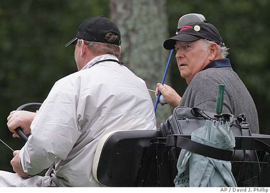 Billy Casper, right, is carried by cart back to the 11th tee after he was unable to find his ball during first round play of the 2005 Masters at the Augusta National Golf Club in Augusta, Ga., Thursday, April 7, 2005. (AP Photo/David J. Phillip) Photo: DAVID J. PHILLIP