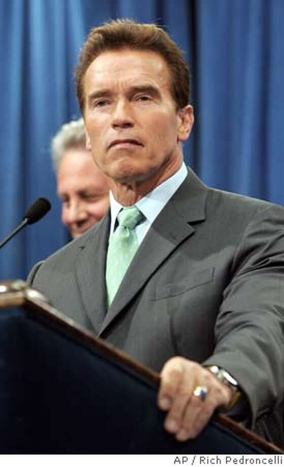 "Gov. Arnold Schwarzenegger listens to a question dealing with the governor's withdrawal of his plan to partially privatize California's public employee pension system, during a Capitol news conference held in Sacramento, Calif., Thursday, April 7, 2005. Schwarzenegger said ""misconceptions"" by firefighters and police officers that his plan would strip them of death and disabiliy benefits had come to dominate the issue. (AP Photo/Rich Pedroncelli) Photo: RICH PEDRONCELLI"