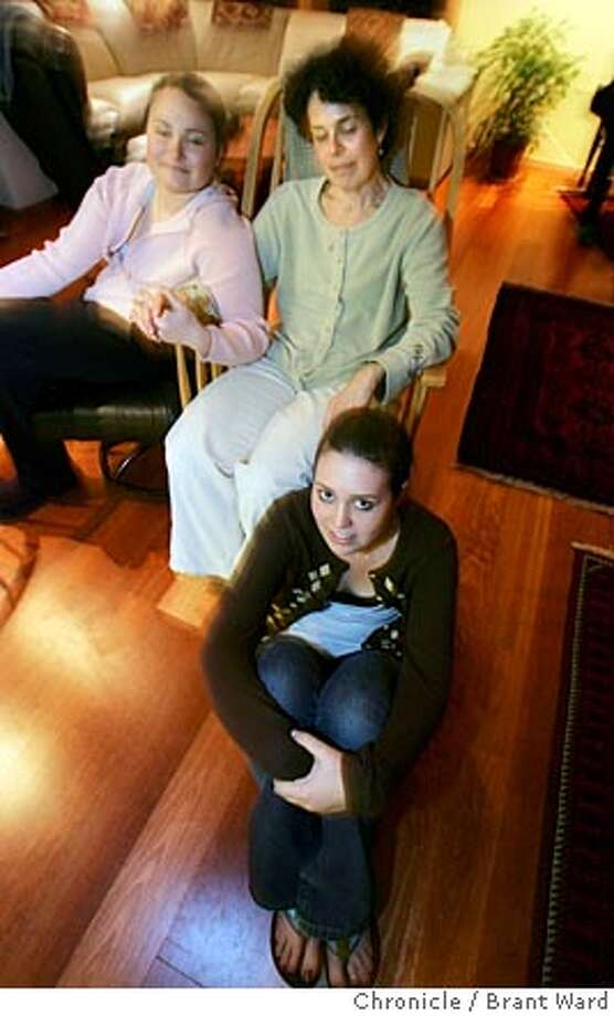 clockwise from top...Hillery, the mom, Gina, and Devon Jaffe Urell spend some quality time at home together now.  Hillery Jaffe Urell was diagnosed with cancer 10 years ago and one of her first fears was that she wouldn't see her 4 and 8 year old girls grow up. She was one of the first to use the Mothers Living Stories project. Now her cancer is in remission and she loves spending time with her teens at their Mill Valley home.  Brant Ward 3/3/05 Photo: Brant Ward
