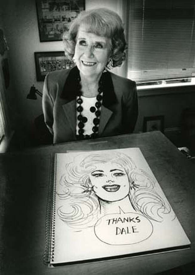 Brenda Starr thanks cartoonist Dale Messick for creating her and getting her into movies in exclusive Chronicle photo at Messicks's Santa Rosa studio (7-30-86)