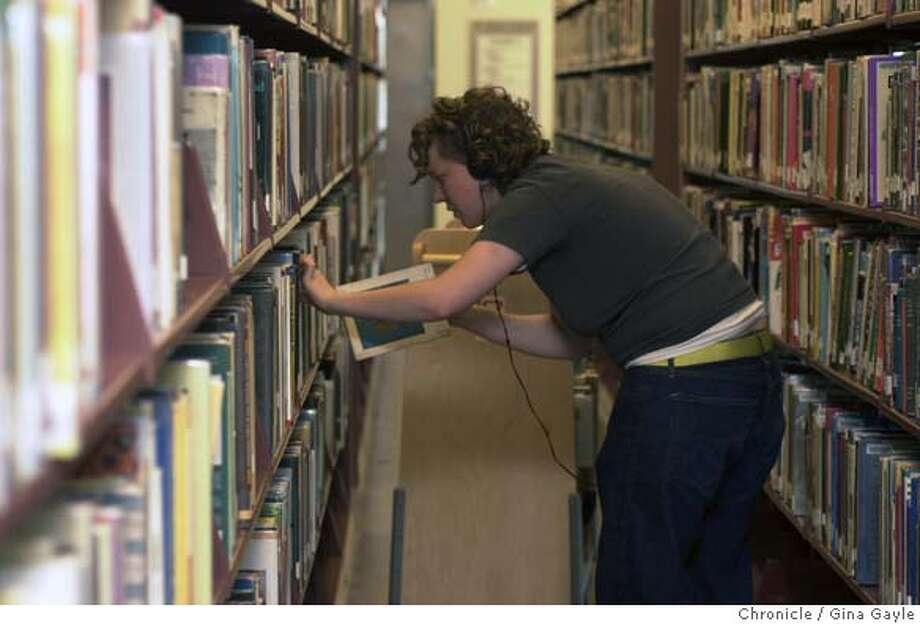 LIBRARY00d-C-27MAR02-MT-GG-Gina Goitta shelves books in the Art and Music section in preparation for the the reopening of the refurbished Berkeley Main Library. Photo by Gina Gayle/The SF Chronicle. CAT Metro#Metro#Chronicle#10/16/2004#ALL#5star##421883046 Photo: GINA GAYLE