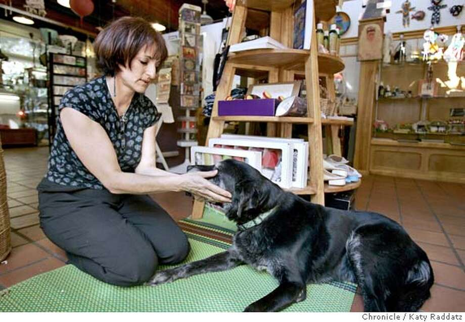 """Keren Bloomfield, in her store called Art Forms, with her dog """"Pepper."""" Photo: Katy Raddatz"""
