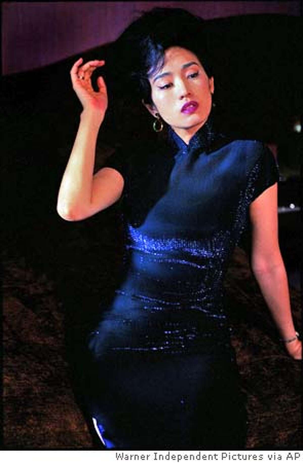 """In this photo provided by Warner Independent Pictures, Gong Li in a scene from """"Eros, """" an anthology of three short films, each somehow touching on the subjects of love and sexuality. (AP Photo/Warner Independent Pictures)"""