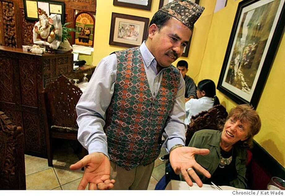 "On 3/31/05 in Berkeley at the new Nepalese restaurant, ""Taste of the Himalayas,"" Rajen Thapa (CQ) chats with diners Miriam Chaya and (NOT PICTURED) Bernie Freedman of El Cerrito.  Kat Wade/ The Chronicle Photo: Kat Wade"