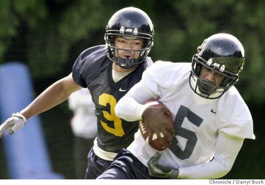 calfootball084_db.jpg  Cal football practice Jonathan Makonnen (#5) hauls down a pass with James Bethea (#3) defending at a scrimmage. 7/30/03 in Berkeley.  DARRYL BUSH / The Chronicle Ran on: 10-15-2004  Jonathan Makonnen was Cal's top receiver two seasons ago but has been beset by injuries since. Photo: DARRYL BUSH