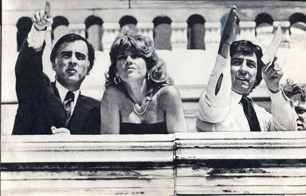 GOVERNOR JERRY BROWN (LEFT) AND JANE FONDA WITH TOM HAYDEN LOOK AT THE LARGEST GATHERING OF ANTI-NUCLEAR PROTESTERS IN U.S. HISTORY IN WASHINGTON, D.C. ON MAY 6, 1979. PHOTO BY WASHINGTON POST
