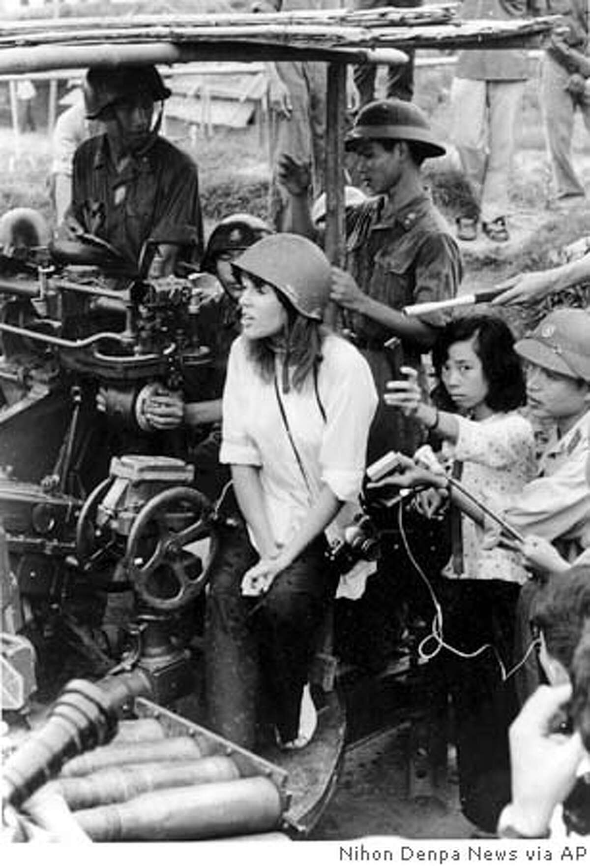 **FILE** American actress and activist Jane Fonda, surrounded by soldiers and reporters, sings an antiwar song near Hanoi during the Vietnam War in July 1972. Fonda, seated on an antiaircraft gun, is among a long line of celebrities who have waded into the treacherous waters of politics or inhternational relations. (AP Photo/NIHON DENPA NEWS) CAT JAPAN OUT. B/W PHOTO ONJLY.