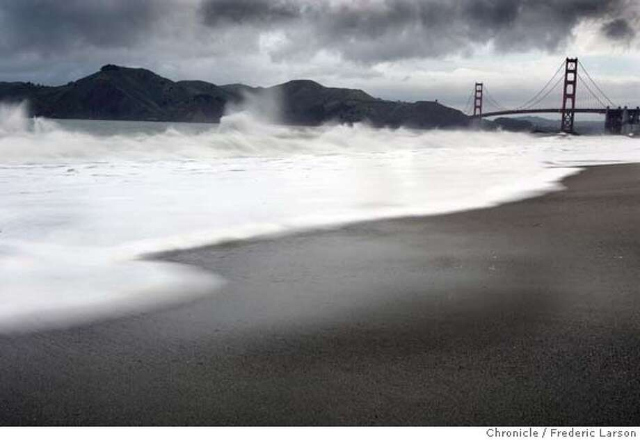 BAKERGGBRIDGE_085a_fl.jpg The morning rains stirred up the ocean at Bakers Beach as heavy dark rain clouds moved in over the hills of Marin and the Golden Gate Bridge. 4/7/05 San Francisco CA Frederic Larson The San Francisco Chronicle Photo: Frederic Larson