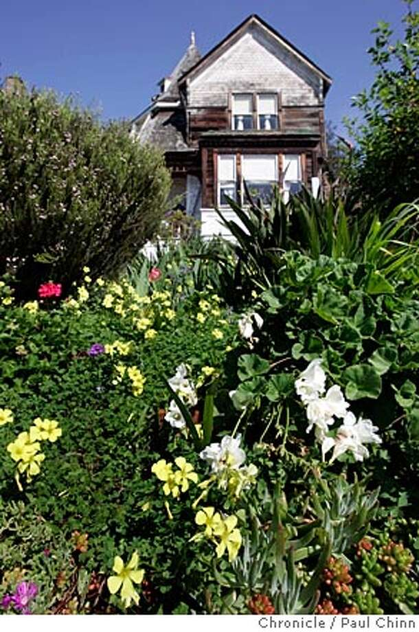 Flowers bloom in the front yard of an 1886 Victorian by architect Ira Boynton at 1431 Arch St. Bob Johnson, a member of the Berkeley Landmark Preservation Commission, toured of some of the city's most impressive architectural gems on 3/29/05 in Berkeley, CA.  PAUL CHINN/The Chronicle Photo: PAUL CHINN