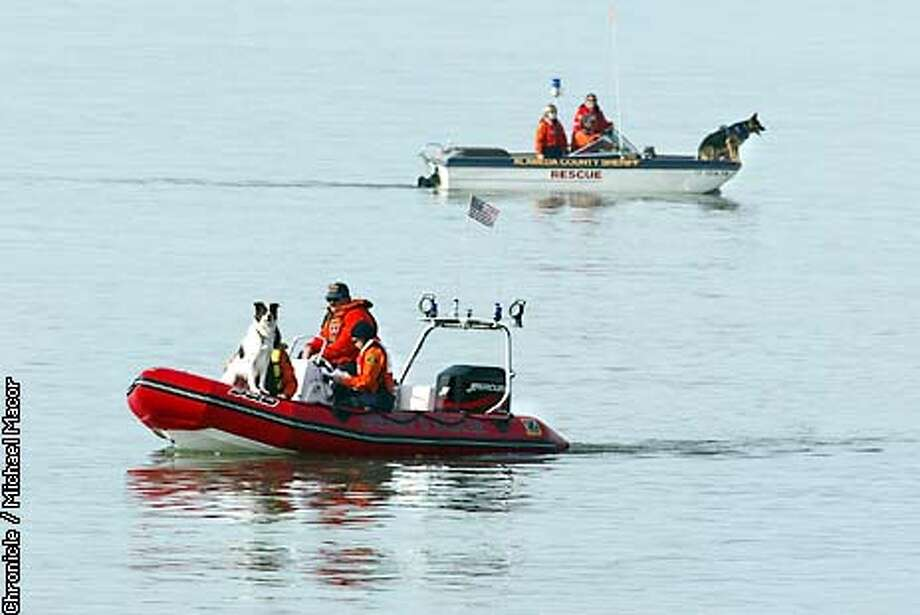 Alameda County Search and Rescue teams used dogs, ( who can detect the gases from a decomposing body through the water) to search the waters off Berkeley Marina in hopes of finding some clue in the case of the missing Modesto woman. 12 days after the disappearance of Laci Peterson of Modesto, Police Agencies from throughout the Bay Area conduct a searh of the Berkeley Marina. by Michael Macor/The Chronicle Photo: MICHAEL MACOR