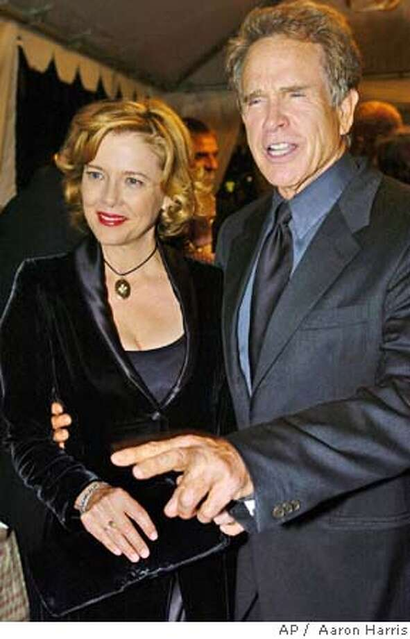 """Actors Annette Bening, left, and Warren Beatty arrive at the gala screening of """"Being Julia"""" at the Toronto International Film Festival in Toronto Thursday Sept. 9, 2004. (AP Photo/CP, Aaron Harris) Ran on: 09-15-2004  Far left: Annette Bening and Warren Beatty attend the screening of &quo;Being Julia&quo; at the Toronto International Film Festival. Left: Lily Tomlin and Dustin Hoffman star in &quo;I (Heart) Huckabees.&quo; Datebook#Datebook#Chronicle#10/15/2004#ALL#5star##0422337271 Photo: AARON HARRIS"""