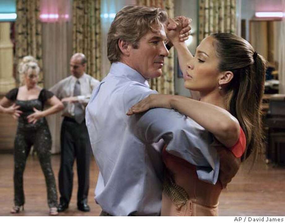 "Dance instructor Paulina (Jennifer Lopez) teaches John Clark (Richard Gere) how to dance the tango in ""Shall We Dance?"" (AP Photo/ David James / Miramax Films) Datebook#Datebook#Chronicle#10/15/2004#ALL#5star##0422407300 Photo: DAVID JAMES"