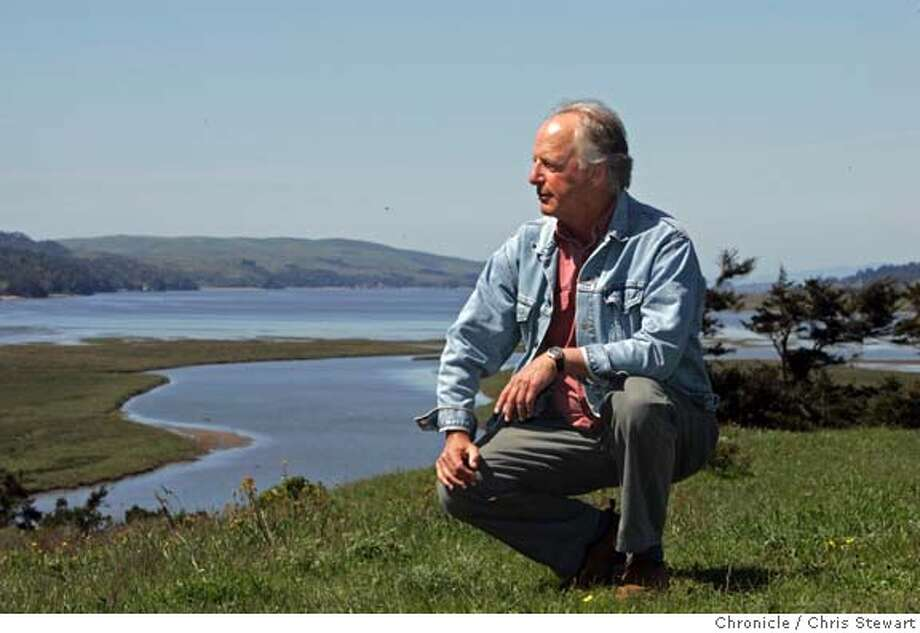 """quakebooks18047.jpg Event on 4/9/05 in Pt. Reyes Station.  California historian Philip Fradkin of Pt. Reyes Station, lives on a ridge above the San Andreas Fault. Here he walks with Tomales Bay in the background, which was formed by the fault. His new book, """"The Great Earthquake and Firestorms of 1906: How San Francisco Nearly Destroyed Itself"""", delves into the mistakes made in 1906 while fighting the post quake fires that swept San Francisco, the suspension of civil liberties and shootings of civilians, and hate crimes against minorities as well as the quake's social aftermath - how the events unleashed a fury of political and economic power shifts.  Chris Stewart / The Chronicle MANDATORY CREDIT FOR PHOTOG AND SF CHRONICLE/ -MAGS OUT Photo: Chris Stewart"""