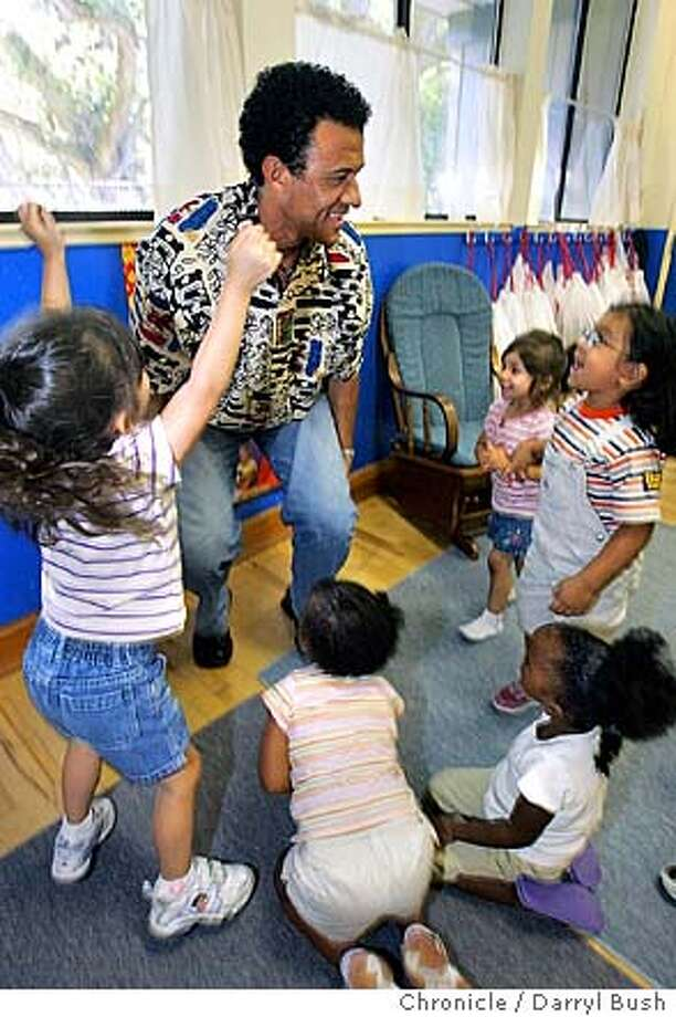Kids jump up around storyteller David Alan Moss of Fair Housing of Marin, as he finishes a story to preschool children at Novato Youth Center of Marin. 9/3/04 in Novato  Darryl Bush / The Chronicle Photo: Darryl Bush