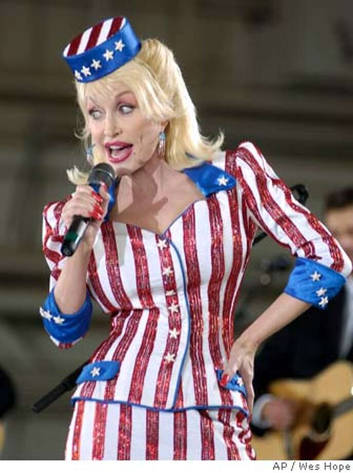 Country music entertainer Dolly Parton performs for members of the 134th Air Refueling Wing Friday morning, September, 24, 2004, in a hangar at McGhee Tyson Air National Guard base in Alcoa, Tenn. after the unveiling of a portrait of Parton that was painted on the side of a KC-135 aircraft. (AP Photo/The Daily Times, Wes Hope) Photo: WES HOPE