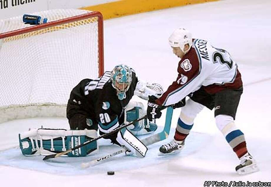 San Jose Sharks goalie Evgeni Nabokov, left, deflects a shot on goal by Colorado Avalanche's Eric Messier during the first period Saturday, Jan. 4, 2003, in San Jose, Calif. (AP Photo/Julie Jacobson) Photo: JULIE JACOBSON