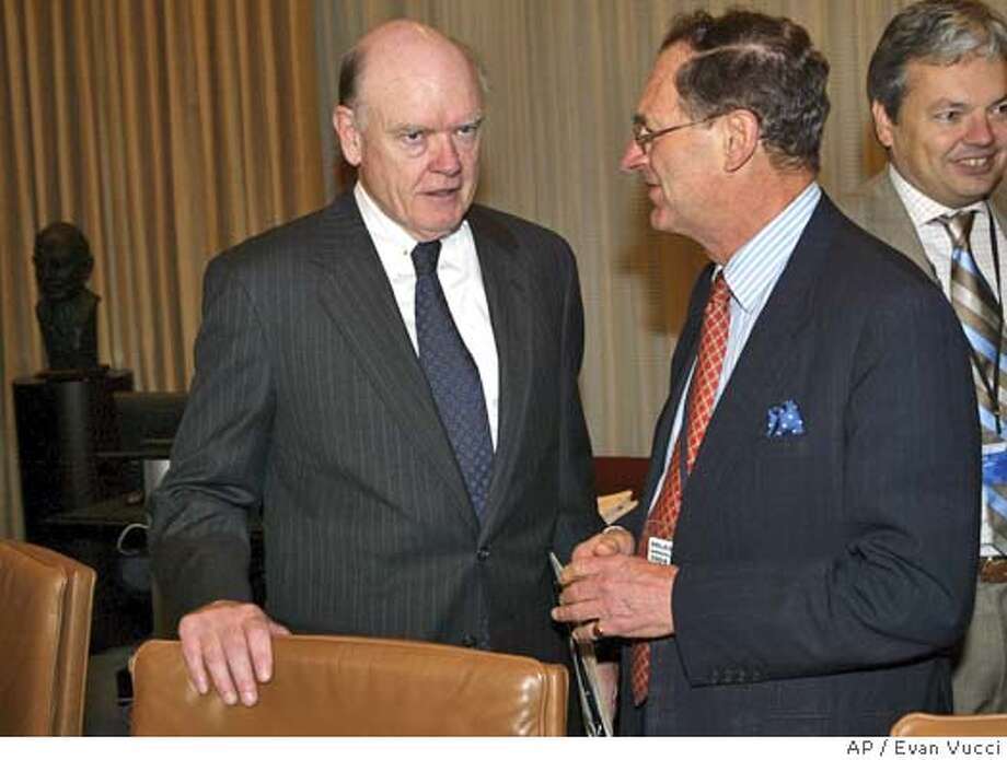 Treasury Secretary John Snow, left, talks with Deputy Governor of the Bank of England Andrew Large, right, before the start of a Group of Ten meeting on Sunday, Oct. 3, 2004 in Washington. (AP Photo/Evan Vucci) Business#Business#Chronicle#10/15/2004#ALL#5star##0422391248 Photo: EVAN VUCCI