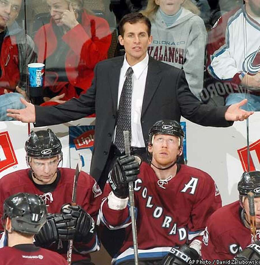 Colorado Avalanche head coach Tony Granato, back, argues a call as his players Radim Vrbata, front left, and Mike Keane look on in the third period of the Avalanche's 5-3 victory over the Vancouver Canucks in Denver on Monday, Dec. 23, 2002. Granato, who assumed the top job last Wednesday, has won the first three games he has coached for the Avalanche. (AP Photo/David Zalubowski) Photo: DAVID ZALUBOWSKI