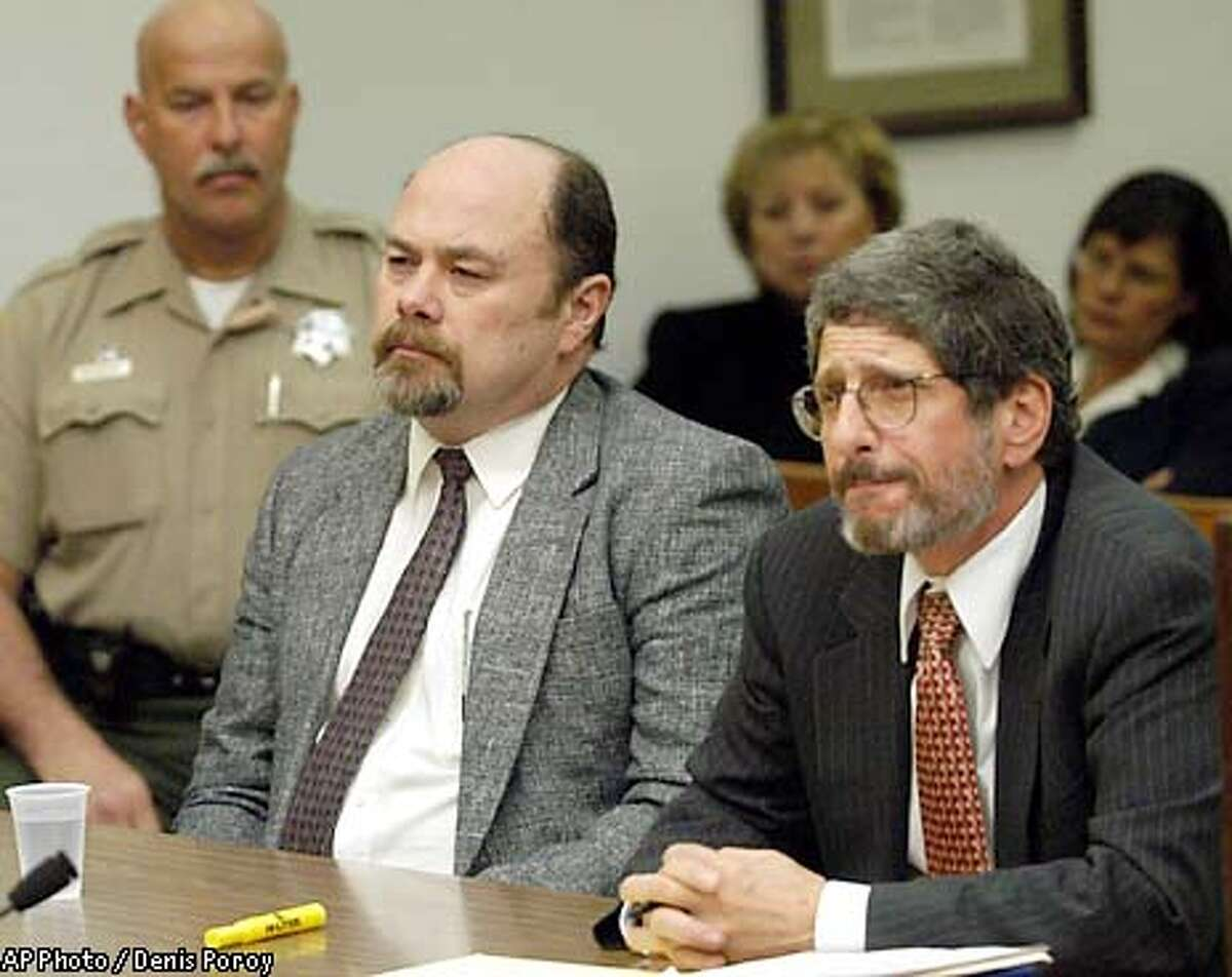 David Westerfield, left, looks forward as Judge William Mudd sentences him to death for the killing of Danielle van Dam as defense attorney Steven Feldman, right, looks on in San Diego Superior Court Friday, Jan. 3, 2002 . Westerfield was sentenced to death for the killing of seven-year old Danielle van Dam. (AP Photo/Denis Poroy )