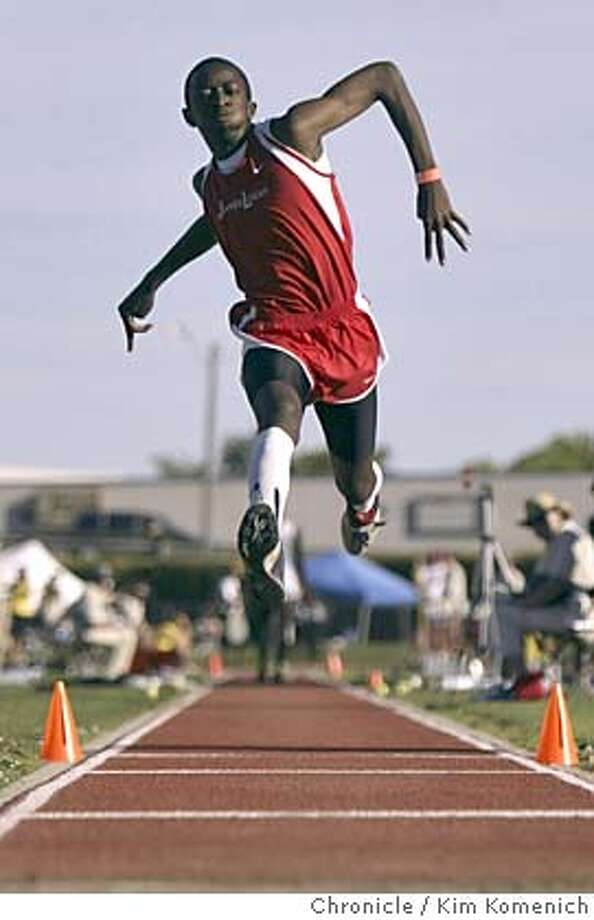 Logan's Nkosinza Balumbu (cq) competes in the triple jump.  Bay Area athletes compete in the California Interscholastic Federation State Track and Field Championships at Sacramento City College.  Photo by Kim Komenich in Sacramento. Photo: Kim Komenich