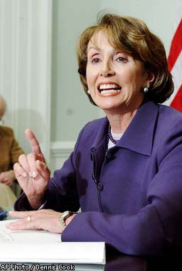 Incoming House Minority Leader Nancy Pelosi, D- Calif., meets with reporters at a news conference on Capitol Hill Friday, Jan 3, 2002. (AP Photo / Dennis Cook) Photo: DENNIS COOK