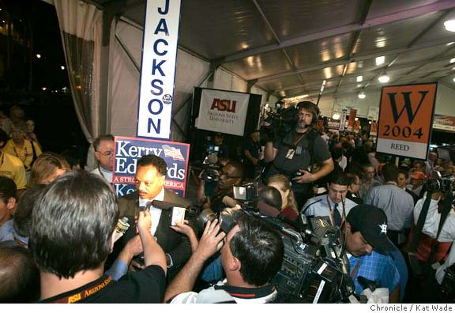 SPINROOM2_026_KW.jpg  On 10/13/04 in Tempe, Az following the third and final presidential debate between George W. Bush and Senator John Kerry Reverend Jesse Jackson (Left) spins some of the 300 journalists while in the background (Right) Ralph Reed, Regional Chairman for South East Bush-Cheney '04 puts his own spin on things at Arizona State University. Chronicle Photo by Kat Wade Ran on: 10-14-2004  Sen. John Kerry (left) and President Bush face off, with moderator Bob Schieffer in the foreground, at the third and final presidential debate at Arizona State University in Tempe. Photo: Kat Wade