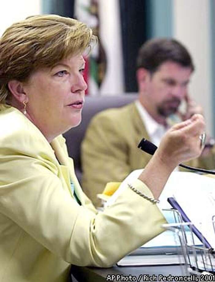 California state schools chief Delaine Eastin recommends that the state Board of Education adopt the proposed test scores for the state's new high school graduation test, during a board meeting Thursday, June 7, 2001, in Sacramento, Calif. The board approved EastIn's recommendation to require students get 60 percent of the English questions and 55 percent of the math questions right on the test before they can graduate from high school. In the background is Board of Education President Reed Hastings. (AP Photo/Rich Pedroncelli) Photo: RICH PEDRONCELLI
