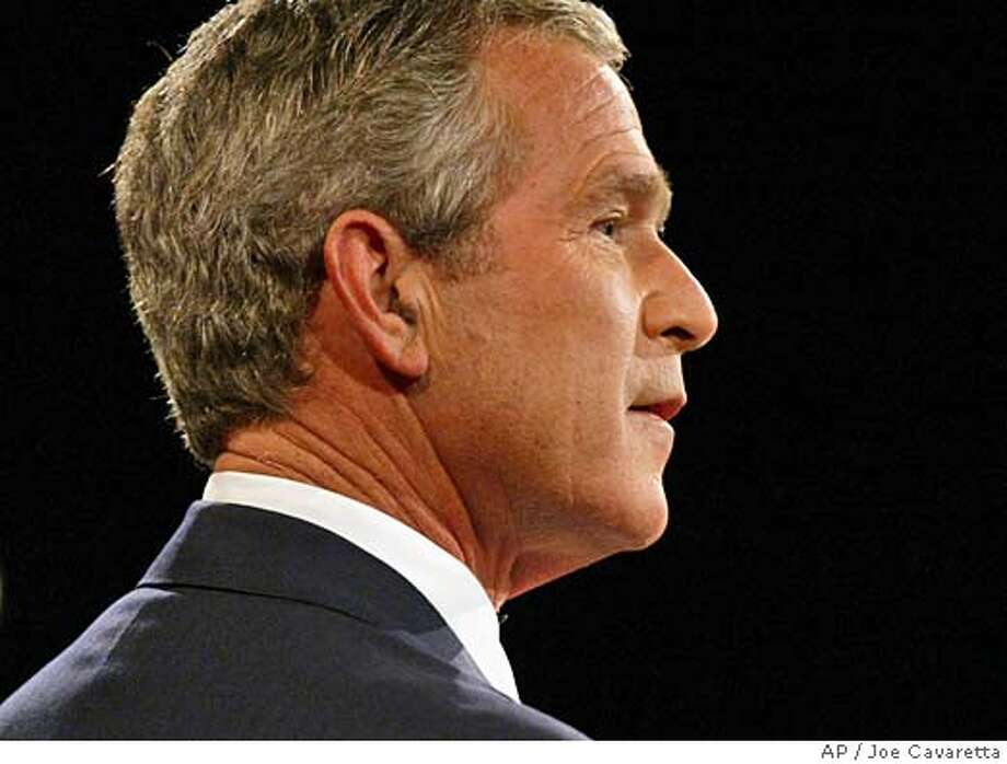 President Bush answers a question during the third and final presidential debate in Tempe, Ariz., Wednesday, Oct. 13, 2004. (AP Photo/Joe Cavaretta) Photo: JOE CAVARETTA