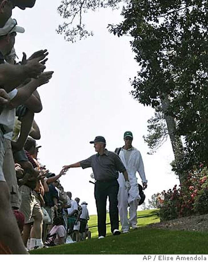 Jack Nicklaus shakes hands with patrons as he walks to the 6th green during practice at the Augusta National Golf Club in Augusta, Ga., Tuesday, April 5, 2005. First round play of the 2005 Masters begins Thursday. (AP Photo/Elise Amendola) Photo: ELISE AMENDOLA