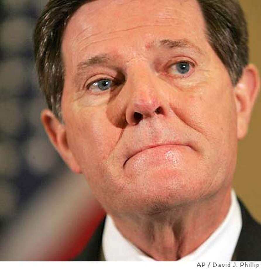 **FILE** House Majority Leader Tom DeLay, R-Texas, listens to a question about the death of Terri Schiavo in this March 31, 2005 file photo in Houston. Defiance defines DeLay, who has three lawyers, one crisis consultant with Justice Department experience and a new support group of conservative activists as he tries to survive allegations of ethical misconduct.(AP Photo/David J. Phillip) A MARCH 31, 2005 FILE PHOTO Photo: DAVID J. PHILLIP