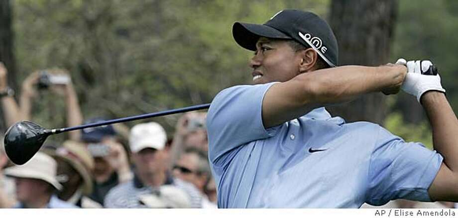 Tiger Woods watches his shot on the 15th hole during practice at the Augusta National Golf Club in Augusta, Ga., Tuesday, April 5, 2005. First round play of the 2005 Masters begins Thursday. (AP Photo/Elise Amendola) Photo: ELISE AMENDOLA