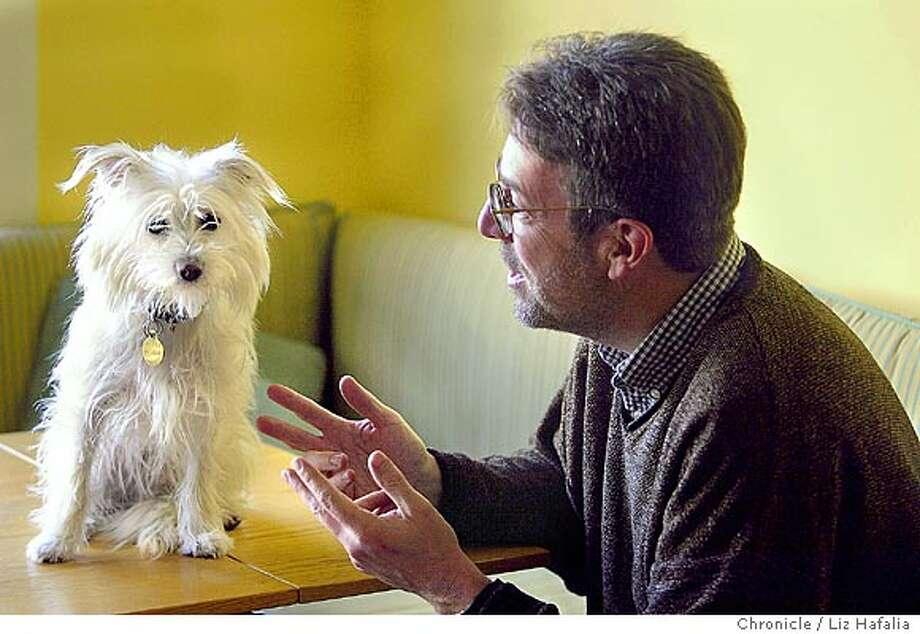 Steven Winn trying to get the attention of the family dog, Como. Shot on 2/4/04 in San Francisco. LIZ HAFALIA / The Chronicle Photo: LIZ HAFALIA