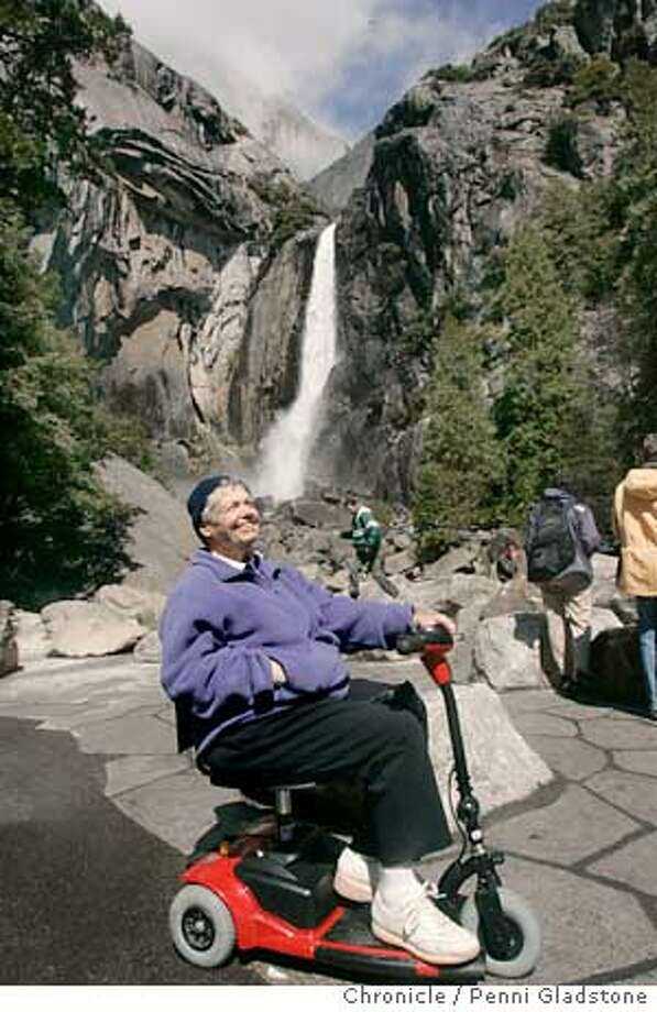 "YOSEMITE135PG.JPG  84 yr old Bernie Horst from Westchester, rides a motorized scooter and says ""no problem"" with the route into Yosemite Falls (behind her) on her scooter.  The Yosemite Fund has completely revamped the viewing area at Yosemite Falls in Yosemite and plans to redo the park museum. This is seen by about 3 million people a year. The yosemite fund has put in new paths, new bridges.The San Francisco Chronicle, Penni Gladstone  Photo taken on 4/4/05, in Yosemite, Photo: Penni Gladstone"