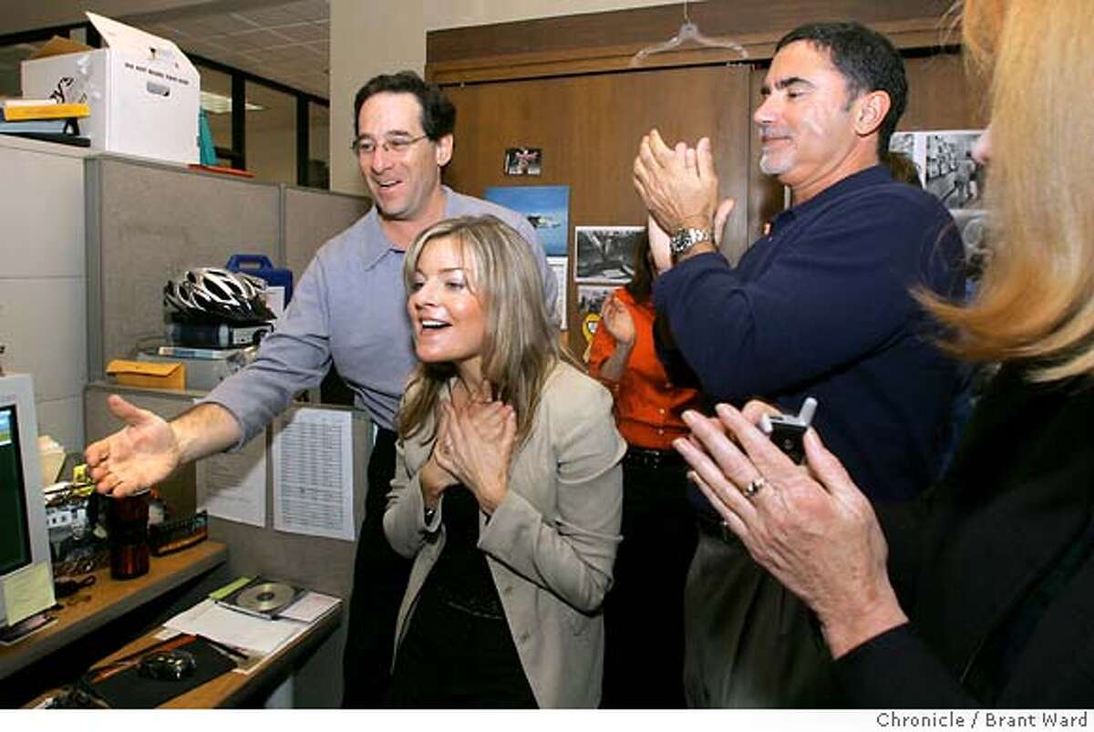 Robert Rosenthal, left, and Phil Bronstein react as Deanne is named a Pulitzer winner. Deanne Fitzmaurice celebrates as she is named the Pulitzer Prize winner for Feature Photography Monday. She is surrounded by editors around the Photography Editor desk. Brant Ward 4/5/05