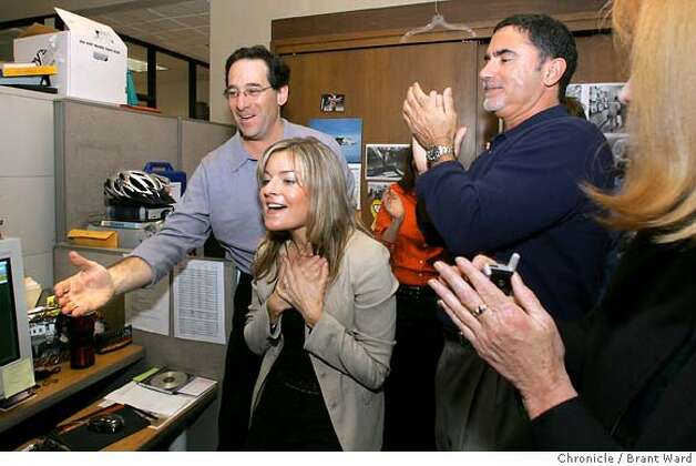 Robert Rosenthal, left, and Phil Bronstein react as Deanne is named a Pulitzer winner.  Deanne Fitzmaurice celebrates as she is named the Pulitzer Prize winner for Feature Photography Monday. She is surrounded by editors around the Photography Editor desk. Brant Ward 4/5/05 Photo: Brant Ward
