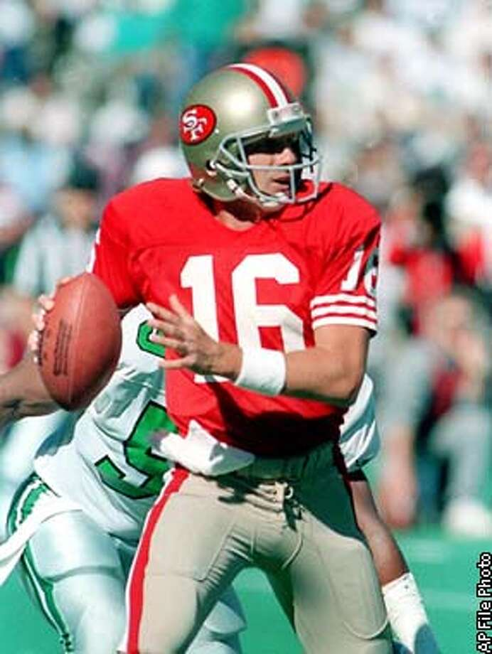 FILE -- San Francisco 49ers quarterback Joe Montana looks for a receiver during a game against the Philadelphia Eagles in Philadelphia, in this September 24, 1989 photo. Montana will be inducted into the Pro Football Hall of Fame in Canton, Ohio Saturday July 29, 2000. (AP Photo/Rusty Kennedy) Photo: RUSTY KENNEDY