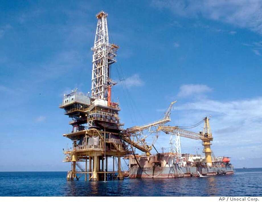 This undated photo provided by the Unocal Corporation shows a natural gas drilling platform in the Gulf of Thailand. The ChevronTexaco Corp., the second largest U.S. oil company, is considering making a bid for it's smaller rival Unocal Corp., The Wall Street Journal reported Thursday, March 3, 2005. (AP Photo/Unocal Corp.) Ran on: 03-04-2005  David O'Reilly is chairman and CEO of ChevronTexaco, reportedly considering a bid for Unocal.