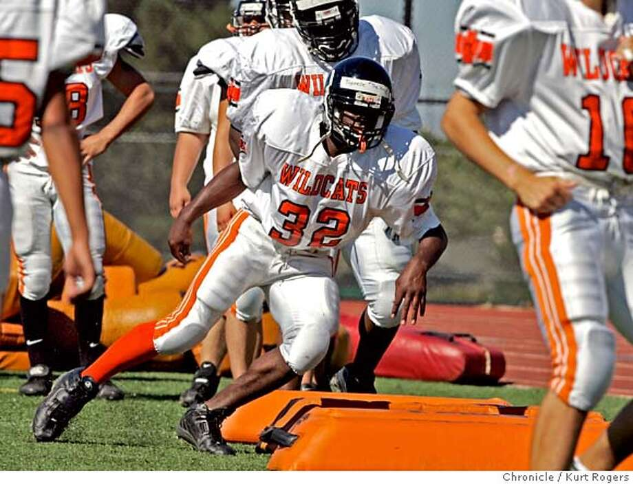 Tyreece Jacks goes through the drill on the teams first with full pads on .  Woodside football had a miserable 2003 season and is trying to recover PNWOODSIDE_0122_kr.JPG 7/18/04 in Woodside,CA.  Kurt Rogers/The Chronicle MANADATORY CREDIT FOR PHOTOG AND SF CHRONICLE/ -MAGS OUT Sports#Sports#Chronicle#10/13/2004#ALL#5star##0422273443 Photo: Kurt Rogers