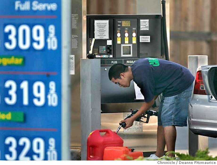 gasprices_007_df.JPG  Peter Tran fills up gas cans for his aunt's catamaran trip to Mexico after he fills up his Honda Civic's tank at R&S Service gas station in Tiburon costing him $50. The full service prices there are over three dollars a gallon.  Deanne Fitzmaurice / The Chronicle MANDATORY CREDIT FOR PHOTOG AND SF CHRONICLE/ -MAGS OUT Nation#MainNews#Chronicle#10/13/2004#ALL#5star##0422409812 Photo: Deanne Fitzmaurice
