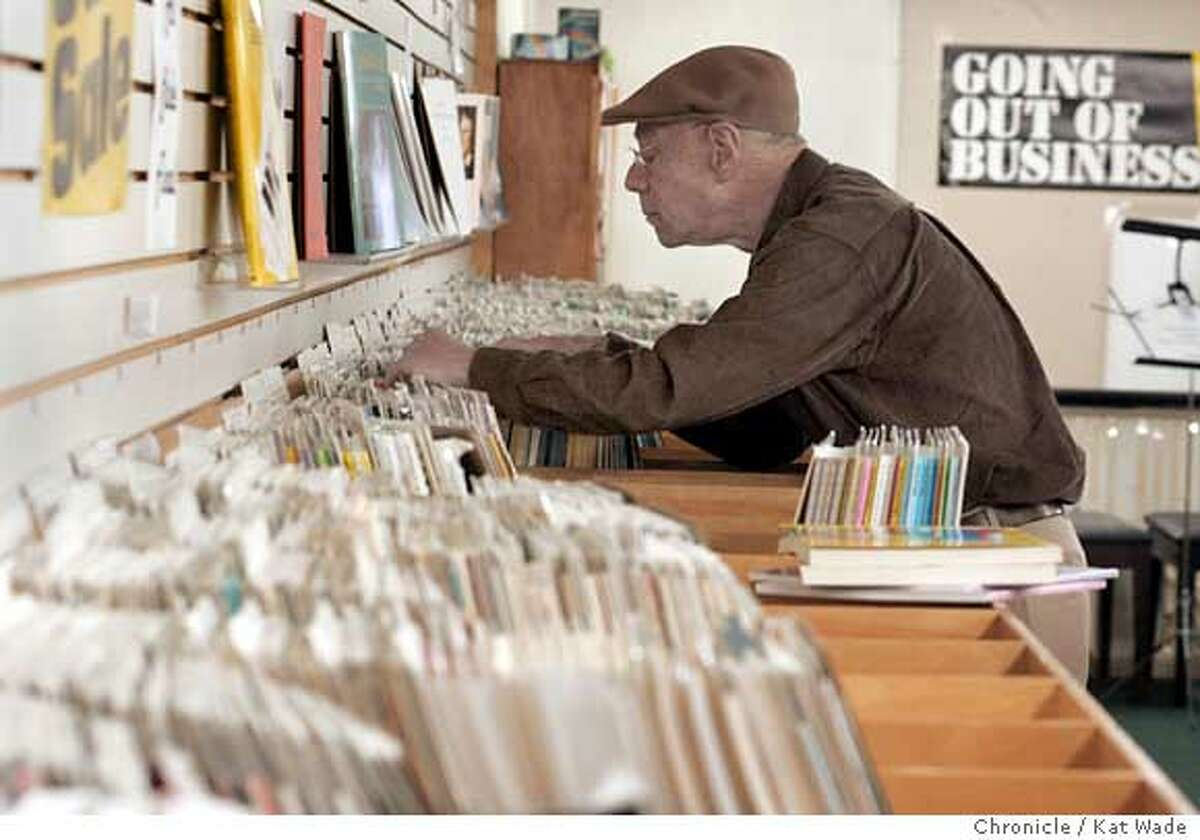 On 4/4/05 in Berkeley(L to R) Classical pianist Michael Seal looks for deals on sheet music at the oldest retail store in Berkeley, the 99 year-old Tupper and Reed Music Store is going out of business with everything discounted for quick sale. Kat Wade/ The Chronicle