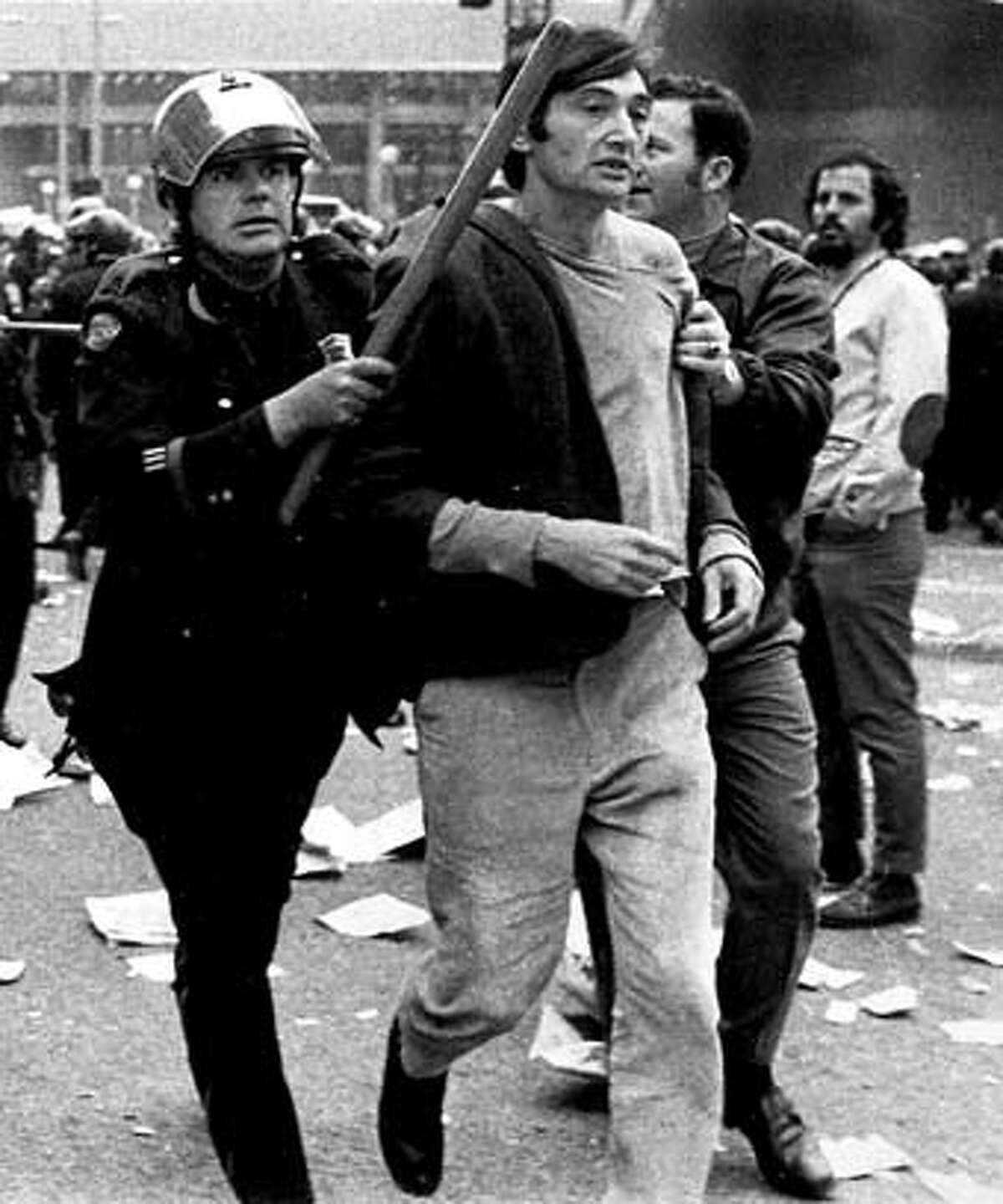 Zinn1: Howard Zinn is arrested at an anti-Vietnam war rally, during the height of the war. (Not sure what year this picture was taken) Datebook#Datebook#Chronicle#10/13/2004#ALL#Advance##0422407536