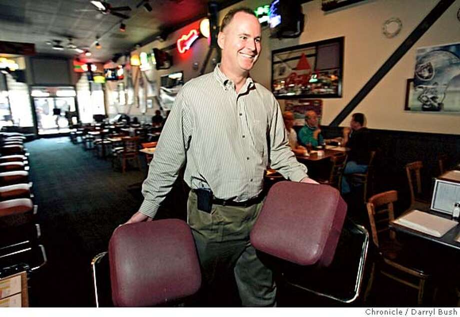 sharkssanjose13_073_db.jpg  Co-owner John Conway, removes bar stools that need repair, inside his Britannia Arms pub, a local business affected by the hockey lockout near HP Pavillon. 10/8/04 in San Jose  Darryl Bush / The Chronicle MANDATORY CREDIT FOR PHOTOG AND SF CHRONICLE/ -MAGS OUT Nation#MainNews#Chronicle#10/13/2004#ALL#5star##0422402409 Photo: Darryl Bush