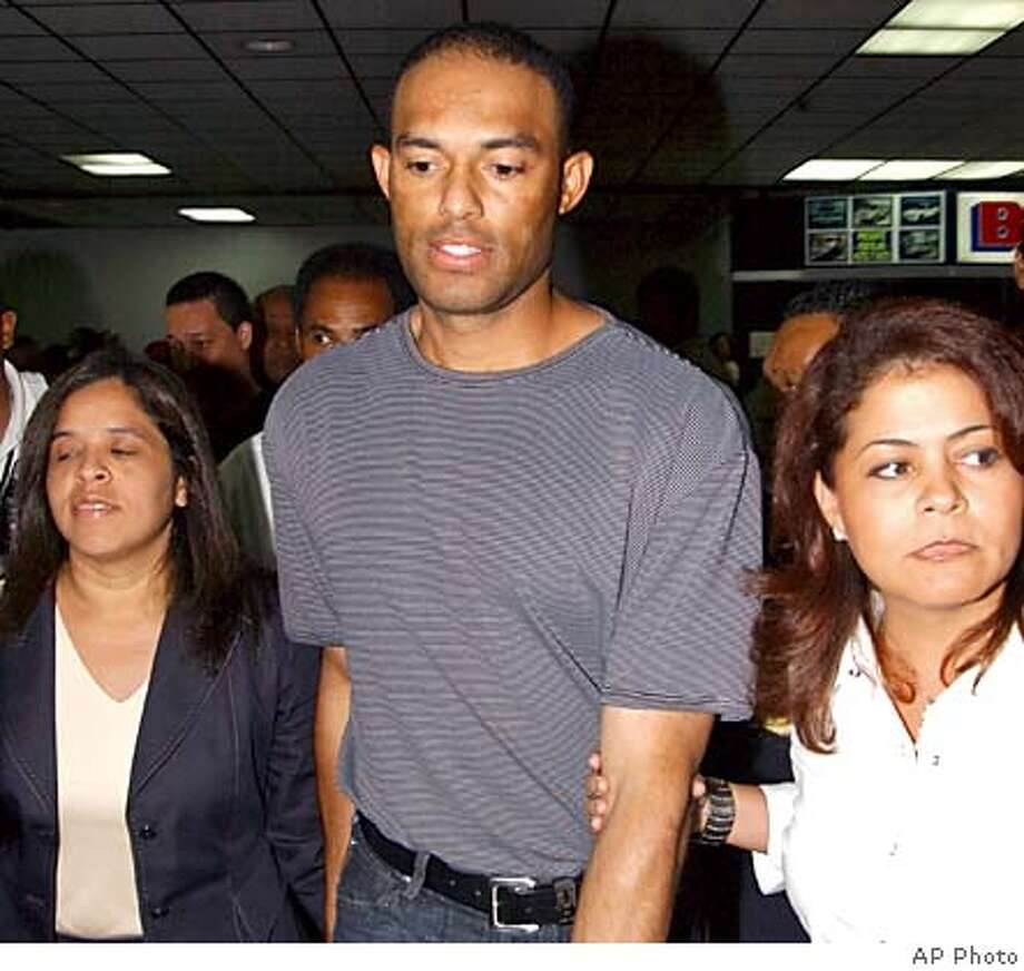 New York Yankees pitcher Mariano Rivera arrives at the Tocumen International Airport, Panama City, along with his wife Clara, right and other relatives and friends, Sunday night, Oct. 10, 2004. Rivera flew home to comfort relatives Monday after two family members were electrocuted in his pool, but plans to be back in New York when the Yankees open their playoff series with the Boston Red Sox. (AP Photo/Str) **PANAMA OUT ONLINE OUT INTERNET OUT** **PANAMA OUT ONLINE OUT INTERNET OUT** PHOTO MADE AVAILABLE OCT. 11 2004 Sports#Sports#Chronicle#10/12/2004#ALL#5star##0422407744 Photo: STR