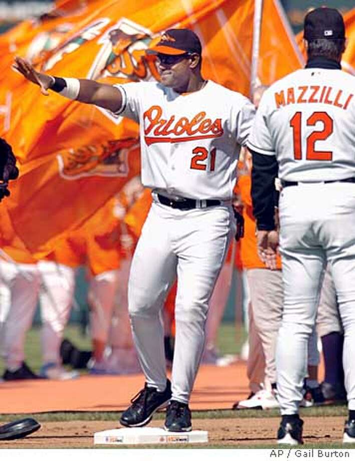 Baltimore Orioles' Sammy Sosa, left, waves to the crowd as he is introduced during opening-day ceremonies in Baltimore Monday, April 4, 2005. Orioles manager Lee Mazzilli waits to shake Sosa's hand at right. The Orioles will face the Oakland Athletics in the afternoon game.(AP Photo/Gail Burton) Ran on: 04-05-2005  Sammy Sosa, waving to the crowd during introductions, went 2-for-4 in his Orioles debut. Ran on: 04-05-2005 Photo: GAIL BURTON