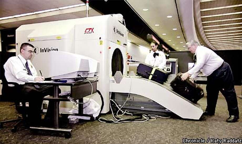 """PHOTO BY KATY RADDATZ--THE CHRONICLE  At SFO we see how the new luggage-checking-for-explosives is working. SHOWN: The machine that goes """"ping"""": luggage being loaded into the CTX 2500 machine. Every single bag is checked for bad stuff. Photo: KATY RADDATZ"""