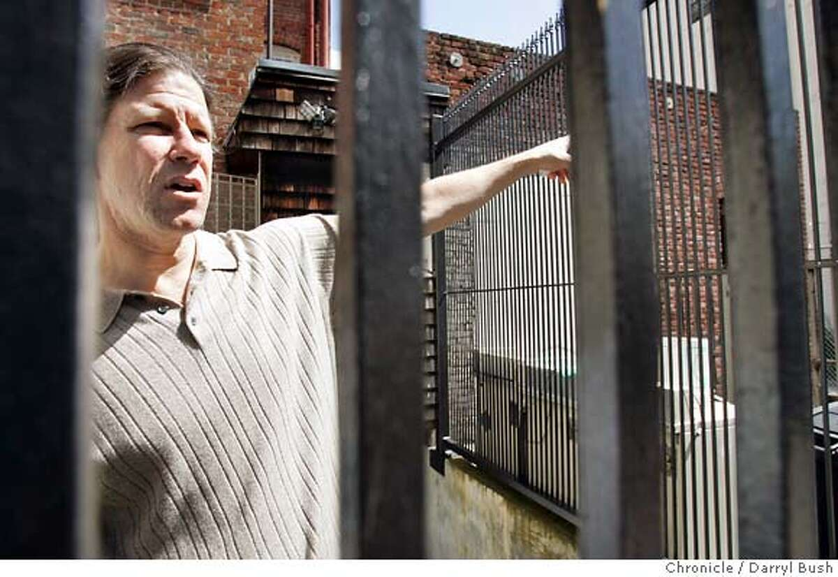 gated30_039_db.jpg Meacham Place resident Bill Orton talks about his property at his home (through the iron gate to his home) on No. 4 Meacham Pl. in the Tenderloin district of San Francisco where residents have put up an iron gate to block out homelessness and drug dealing in their urban neighborhood. Event on 3/29/05 in San Francisco. Darryl Bush / The Chronicle MANDATORY CREDIT FOR PHOTOG AND SF CHRONICLE/ -MAGS OUT