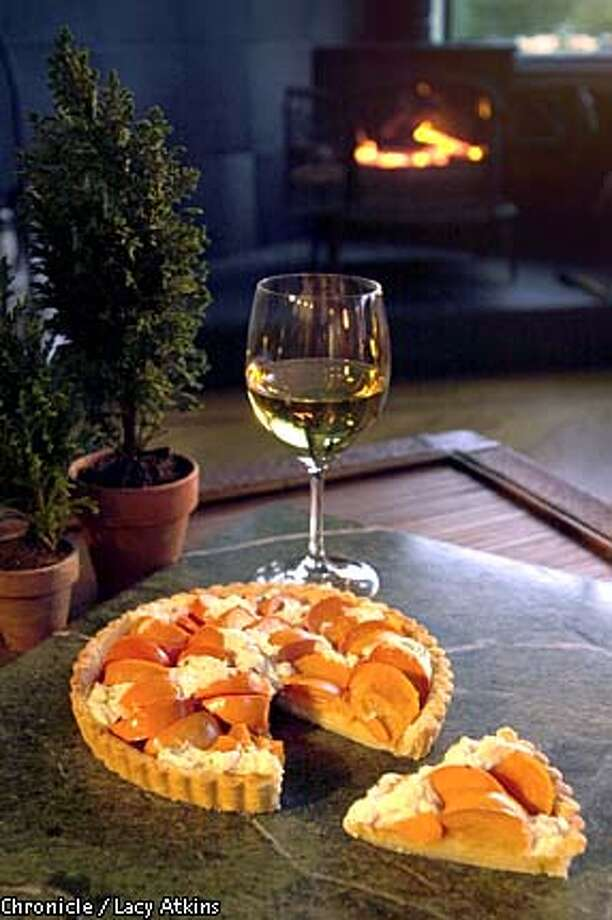 Sweet and Salty: Persimmon and Goat Cheese Tart has a delicious combination of flavor and texture balanced well by the sweetness and complexity of a good dessert wine. Chronicle photo by Lacy Atkins