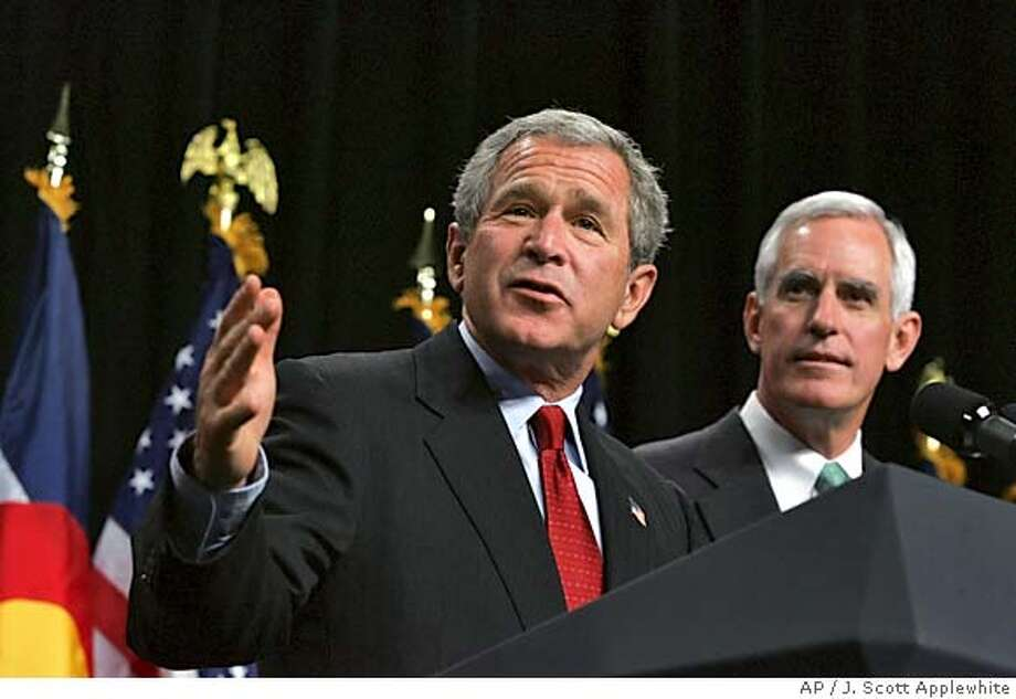 President Bush lends his support to Pete Coors, right, the Republican candidate for U.S. Senate from Colorado, in Denver, Monday, Oct. 11, 2004. Bush is making stops in closely contested Western states this week on the way to the third and final debate with his Democratic opponent, Sen. John Kerry, in Phoenix on Wednesday. (AP Photo/J. Scott Applewhite) Metro#MainNews#Chronicle#10/13/2004#ALL#5star##0422407769 Photo: J. SCOTT APPLEWHITE